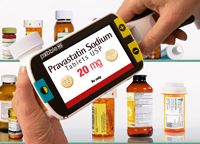 Low vision person using handheld pebble hd magnifier to magnify pill bottle